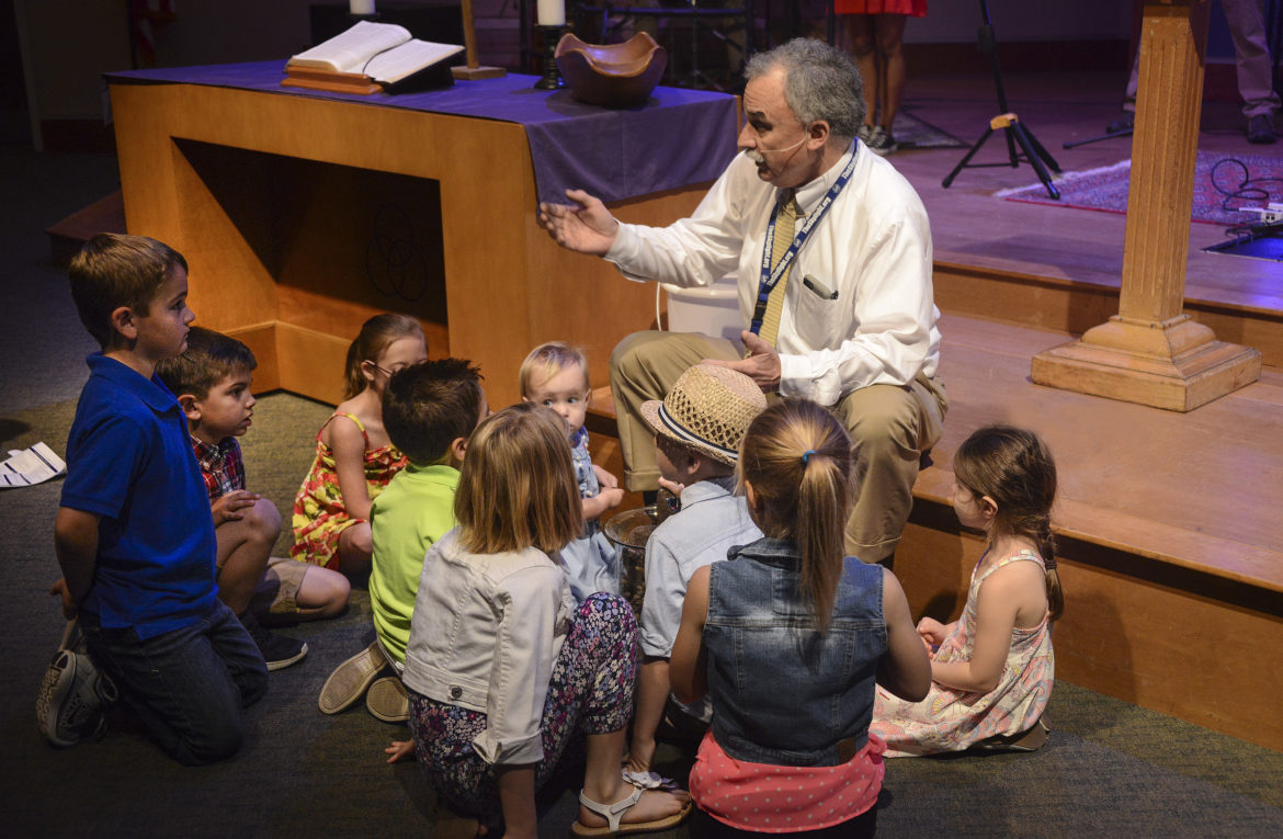 The Rev. Tom McCloskey shares a special message with the children during worship March 19, 2017, at First United Methodist Church in Orlando. (FUMF photo/Alain Boniec)